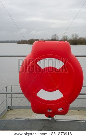 Bright Red Lifebelt Container With Reservoir In Background