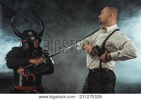 Armored Samurai With Katana Ready To Kill Man While He Taking Out His Gun