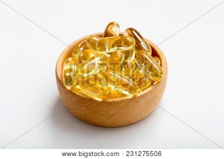 Fish Oil Capsules With Omega 3 And Vitamin D. Healthy Diet Concept.