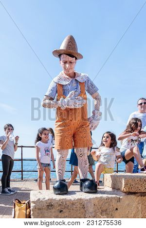 Caesarea, Israel, March 03, 2018 :  A Participant Of The Purim Festival Dressed In Pinocchio Costume