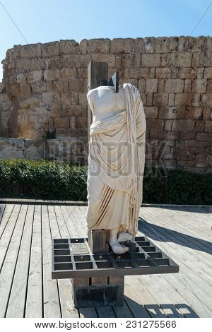 Partially Preserved Statue Of White Marble In The Ruined City Of Caesarea In Israel.