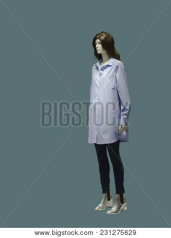 Full-length Female Mannequin Wearing Shirt Dress, Isolated. No Brand Names Or Copyright Objects.
