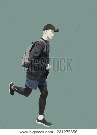 Running Male Mannequin Isolated Over Green Background. No Brand Names Or Copyright Objects.