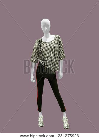 Full-length Female Mannequin Dressed In Casual Clothes, Isolated. No Brand Names Or Copyright Object