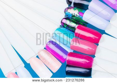 palette with swatches of nail Polish. a collection of samples of varnish for manicure. well-groomed hands, healthy nails. Copy space.Finger nail art design samples. poster