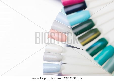 Palette With Swatches Of Nail Polish. A Collection Of Samples Of Varnish For Manicure. Well-groomed