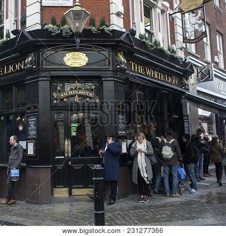 London - October 27, 2016: Local Drink Beer, Standing Near The Pub The White Lion
