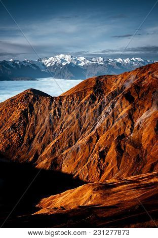 Fantastic panorama view shrouded in mist at the foot of mountain Ushba. Location Upper Svaneti, Mestia, Georgia, Europe. High Caucasus ridge. Beautiful nature landscape. Discover the beauty of earth.