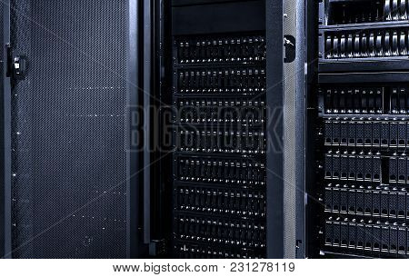 Information Technology And Big Data Concept. Rackmount Many Hard Disks Drive In Enclosure In The Sto