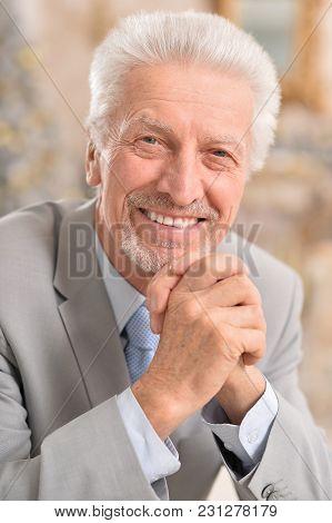 Portrait Of A Senior Man Thinking Indoors