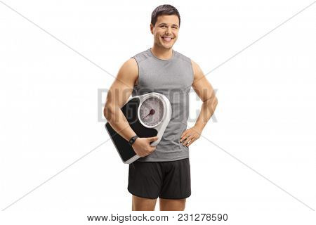Young man in sportswear holding a weight scale isolated on white background