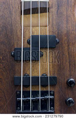 Body Of A Classic Bass Guitar.electric Bass Guitar Element.guitar Neck Closeup.chord.selective Focus