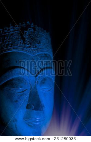 Spiritual Enlightenment Buddha Head In Mindful Meditation Trance. Traditional Statue In Calm Blue To