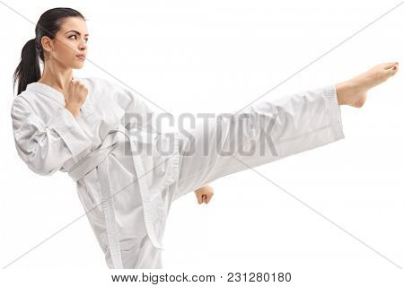 Young woman practicing martial arts isolated on white background