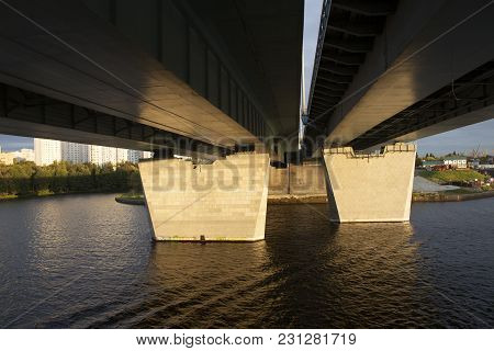 Under A Bridge Perspective From Ship In Sunset