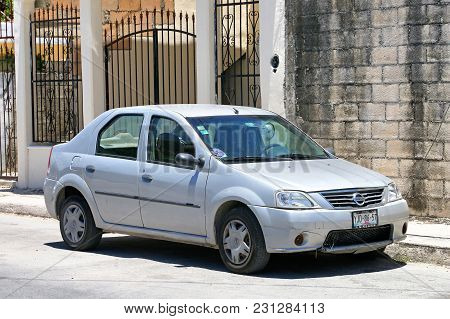 Tulum, Mexico - May 17, 2017: Motor Car Nissan Aprio In The City Street.