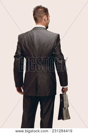 in full growth.rear view.businessman with a briefcase.