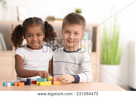 Little kids playing indoors. Child adoption