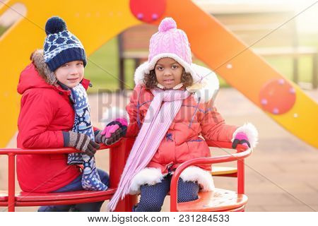 Cute little kids on playground. Child adoption