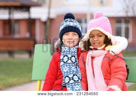 Cute little kids outdoors. Child adoption