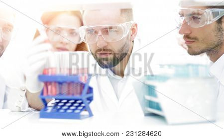 closeup of a group of scientists and pharmacists in the laborato