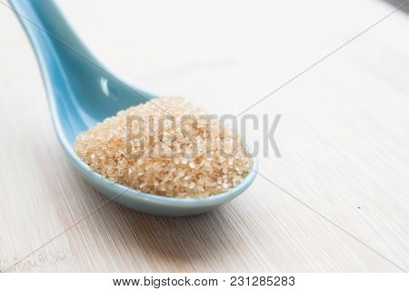 Brown Sugar On Spoon, Diabetes, Unhealthy Diet Concept