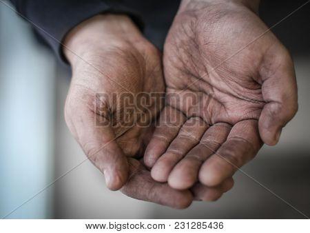 Poor man begging for money, closeup