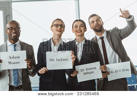 Group Of Businesspeople Waiting For Partners At Departure Zone Of Airport
