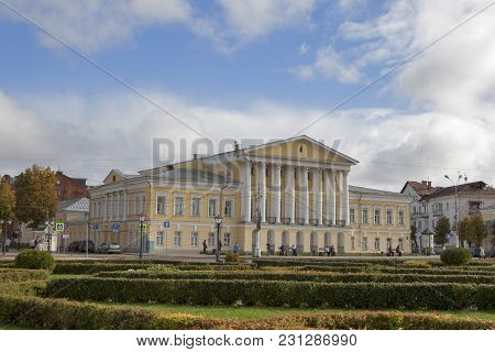 Unidentified People Walk On Susaninskaya Square Near House Of General Borshchov, Kostroma, Russia