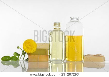 Set of yellow ranunculus and massage oil ,stacked soap