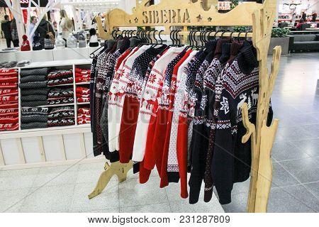 St. Petersburg, Russia - 21 December, Rack With Sweaters, 21 December 2017. Festive Design Of Interi