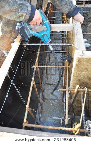 Contractor Mix Concrete In Foundation Slabs With Iron Bars. Mixing Concrete Slab Foundation.