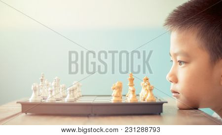 Asian Boy Think Or Plan About Chess Game Selective Focus Vintage Style For Education Or Business Con
