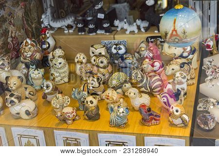 Miniature Ceramic Figures Of Animals And Birds, Made In Old-fashioned Style, In The Window Of A Souv