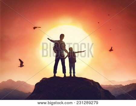 Kid and dad look at sunset. Father and daughter are having fun and enjoying journey.