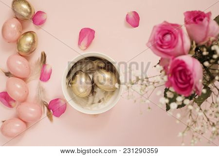 Easter Eggs In A Bowl. Pink And Gold Easter Eggs. Pastel Easter Concept With Eggs, Flowers And Feath