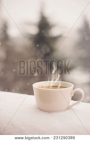 A Coffee In The Snow. Pink Coffee Cup, Coffee Mug. Beautiful Winter Landscape Background. Cozy Winte