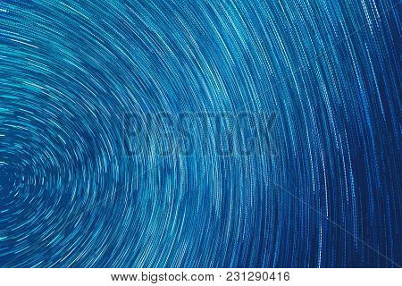 Abstract Grunge Texture Rotation: White Radial Dashed Lines On A Blue Background.
