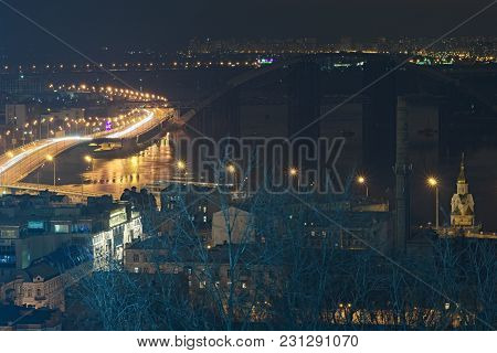 Highway At Night Along The Dnieper River With Tracers And Lights, Havana Bridge And Naberezhno-kresc