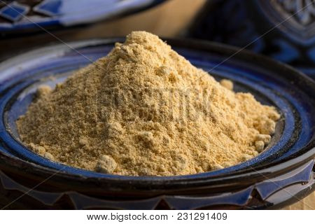 Traditional blue bowl with Moroccan dried ginger powder