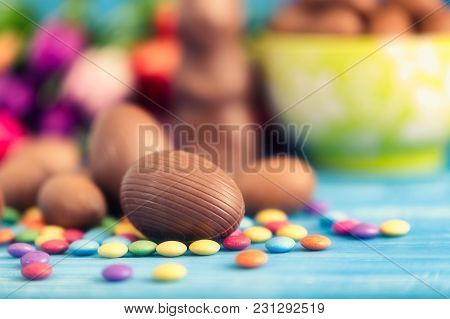 Chocolate Easter Eggs And Tulips