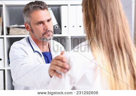 Friendly Male Doctor Hold Patient Shoulder In Office During Reception. Examination Result Positive T