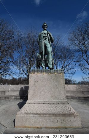 Abraham Lincoln: The Man Statue By Augustus Saint-gaudens In Lincoln Park Chicago, Il, Under A Blue
