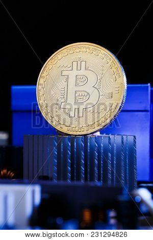 Picture of virtual currency, bitcoin and processor on dark background