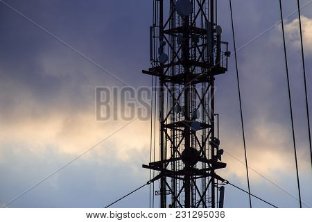 Metal Construction Of Radio Tower Against The Evening Sky