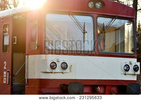 Old Czech Red Train With Sun Rays At Sunset