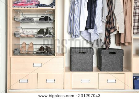 Organized wardrobe closet with clothes and shoes