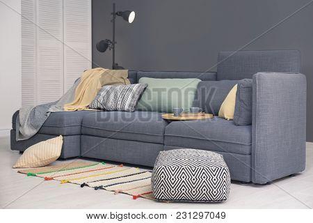 Beautiful room interior with comfortable sofa