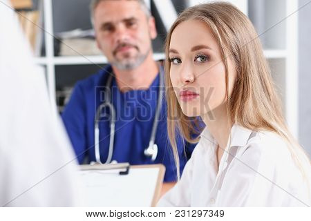 Satisfied Happy Beautiful Smiling Female With Doctor At His Office. High Level And Quality Service T