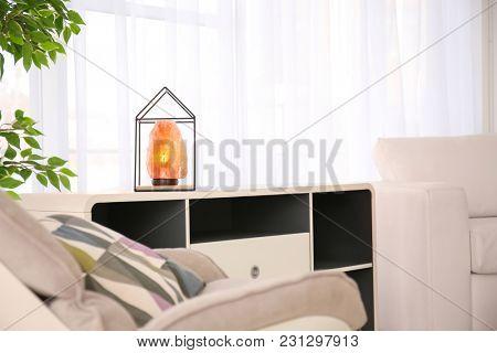 Himalayan salt lamp on shelving unit indoors
